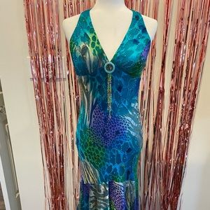 Gorgeous teal colored, beaded, open backed gown!